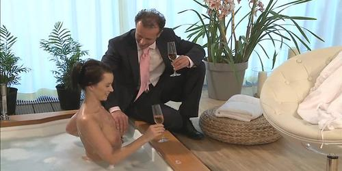 Couple make love in a hot tub