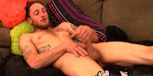 Tattooed guy shows off his balls and wanks it to the end