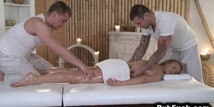 Two masseurs gangbang blonde on a table