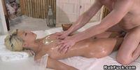 Beautiful blonde fucks masseur in reverse position