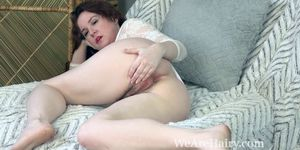 Annabelle Lee lays back in bed to strip naked