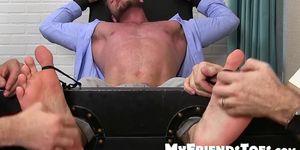 Bound stud endures tickling and foot fetish torment
