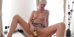 Adorable babe using her toy to please herself