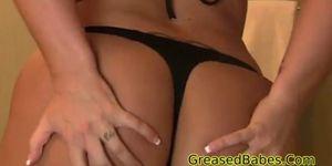 Busty milf strips out of sexy black thong bikini