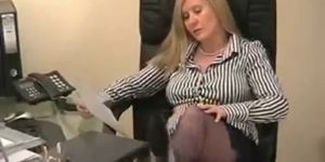 Celeb porn sex tape - Chubby secretary teases in the office in blue silk stockings