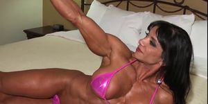 Latina muscle MILF Marina shows off her erotic body in bed