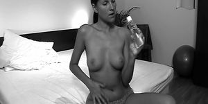 Deny Moor rubs oil over her pussy and Clit