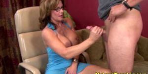 Bigtitted spex milf tugging cock