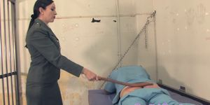 Prisongaurd mistress whipping her sub