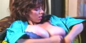 Busty Nicole Reed plays with her big boobs