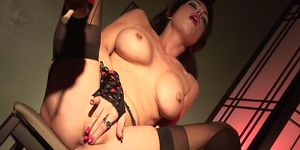 brunette with bigtits moaning while rubbing her clitoris