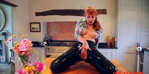 Red XXX fucks herself with a toy while in latex pants
