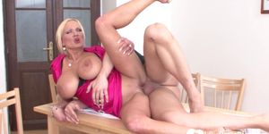 Busty blonde stroking cock and getting rammed