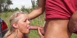 Naughty granny fucked in the trunk during nature road trip