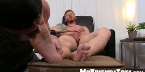 Redhead jerks off and enjoys some amazing toe sucking action