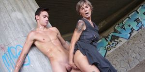 Classy GILF fucked by young stud under the highway