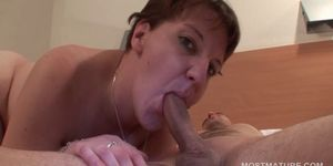 Mature giving BJ gets cum shot on her tits Porn Videos
