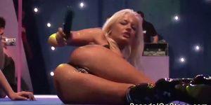 hot babe masturbating on public stage