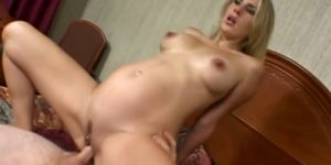 Pregnant babe gets pussy fucked cowgirl style