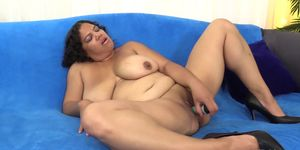 Fat Hoochie Lady Spice Undresses and Pleases Herself with a Vibrator