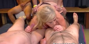 German MILF sucking and fucking at group sex party