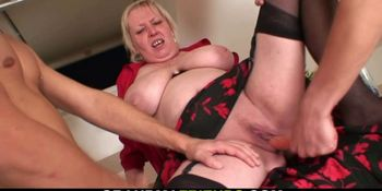 Nasty old granny spreads legs for two dicks