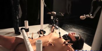 Clamped submissive victim electro play