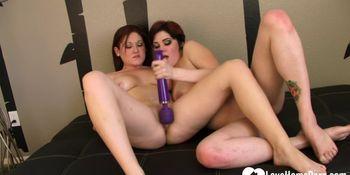 Hot lesbian couple uses a Hitachi sex toy