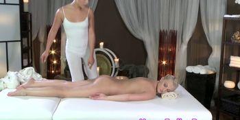 Classy masseuse sliding on lesbian client
