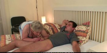 Horny granny wakes him up for taboo sex
