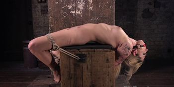 Gagging BDSM submissive gets her pussy toyed
