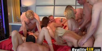 Young swinger boyfriend enjoys a nice and wet blow job from one mature hottie from the group