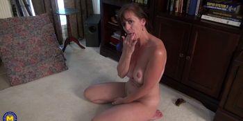 Busty mature lady masturbating